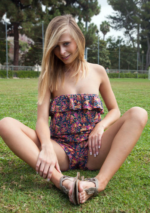 Long haired blonde coed undressing and..