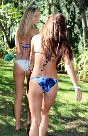 Playful longhaired girls students in..